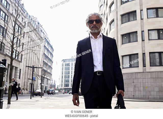 UK, London, UK, portrait of senior businessman walking in the city