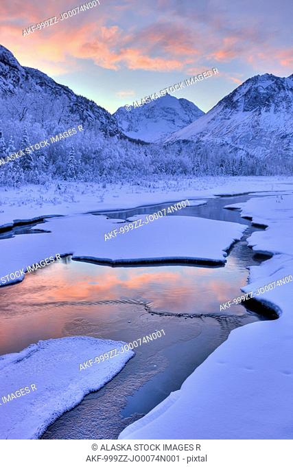 Colorful sunrise over a stream at the Eagle River Nature Center in Chugach State Park, Southcentral Alaska, Winter, HDR