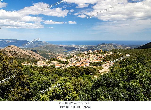 Distant cityscape in valley, Villagrande Strisaili, Ogliastra, Italy