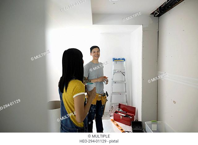 Couple discussing home improvement project