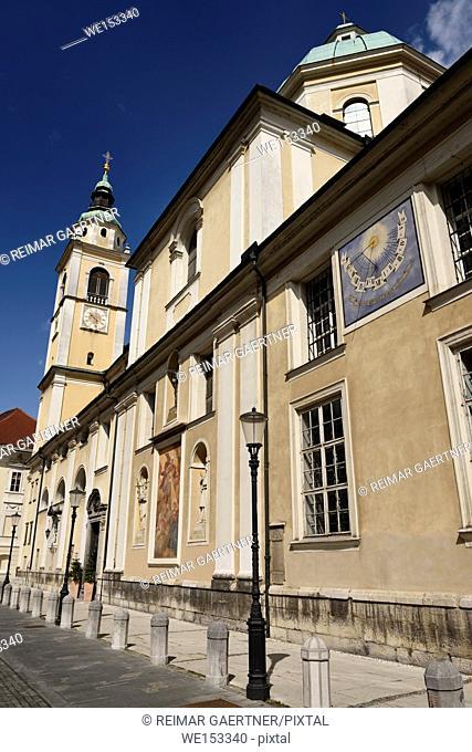 Belfry on south side of St. Nicholas Catholic church Ljubljana Cathedral rwith sundial on Cyril Methodius Square Ljubljana Slovenia