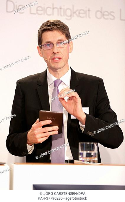 Cief Product & Innovation Officer at Deutsche Telekom AG, Thomas Kiessling, presents the eReader tolino in Berlin, Germany, 01 March 2013
