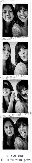 Photo booth picture of teenage girl (14-15) and her mom
