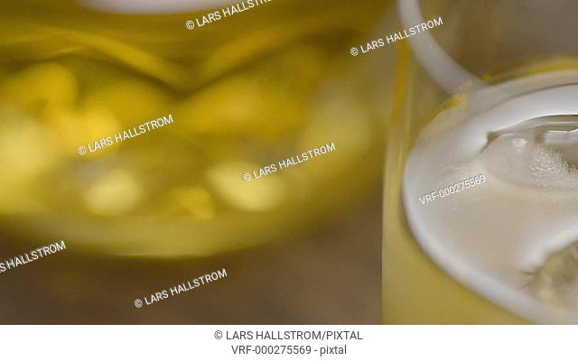 Whiskey and ice cubes in glass, close up. Concept of alcohol. Film clip with slow sliding motion