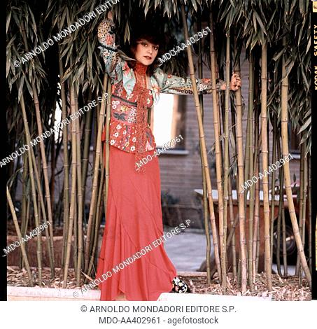Italian singer Mia Martini (Domenica Berté) posing next to some ditch reeds. 1973