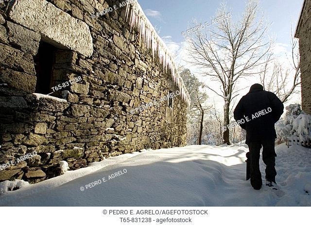 A man walks in the snow in the mountains of O Cebreiro, Lugo