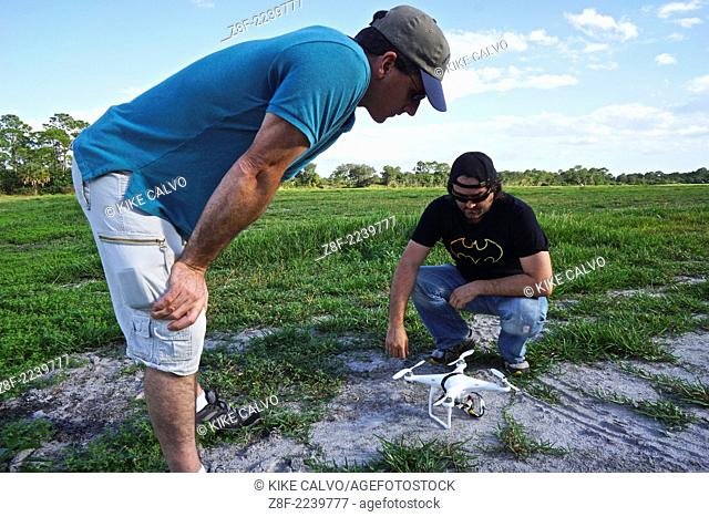 Photographer Kike Calvo learns to fly drones using a DJI Phantom, at a small unmanned aircraft pilot training course at the Unmanned Vehicle University