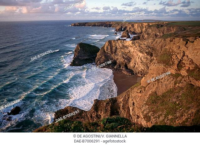Bedruthan Steps' steep cliffs, between Porthcothan and Newquay, Cornwall, United Kingdom