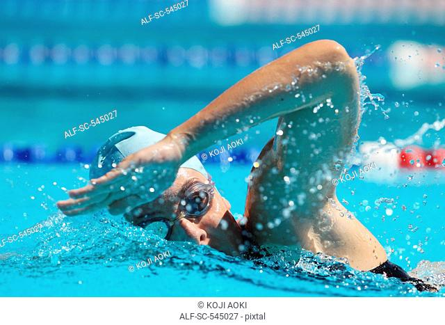 Woman Swimming in Pool, Underwater