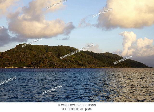 Cloudy sky above islands in sea