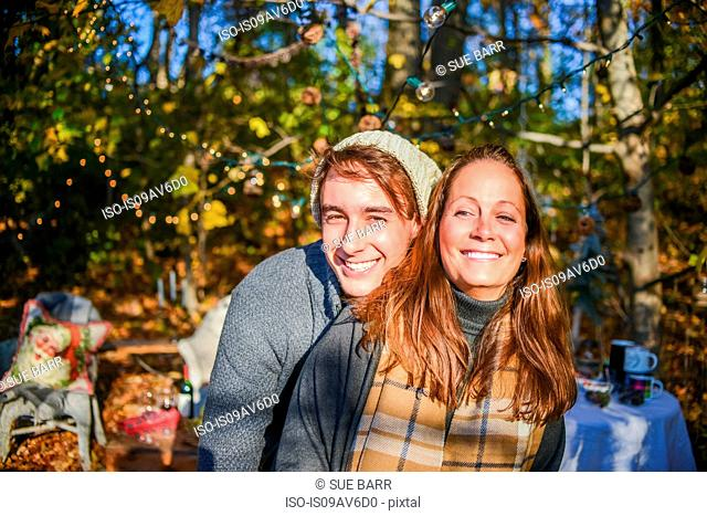 Portrait of young man and mother in woods