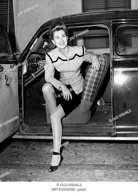 Portrait of woman in drivers seat of car All persons depicted are not longer living and no estate exists Supplier warranties that there will be no model release...