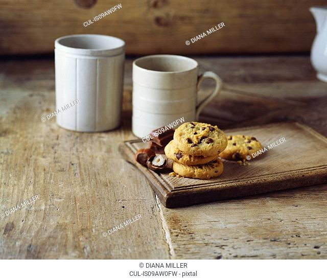 Chocolate and hazelnut cookies on vintage wooden cutting board