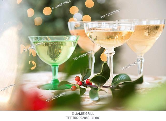 Wine glasses with drinks on festive table