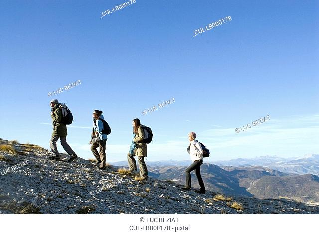 4 people on a trek