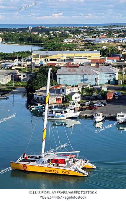 Catamaram browsing the Port of St John, Caribbean island