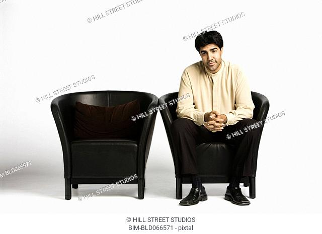 Middle Eastern man sitting in chair