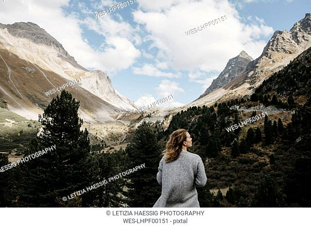 Switzerland, Grisons, Albula Pass, woman standing in mountainscape