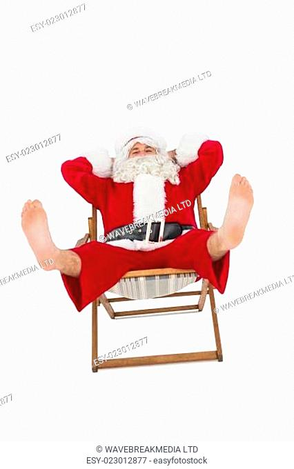 Relaxed santa stiting on deckchair