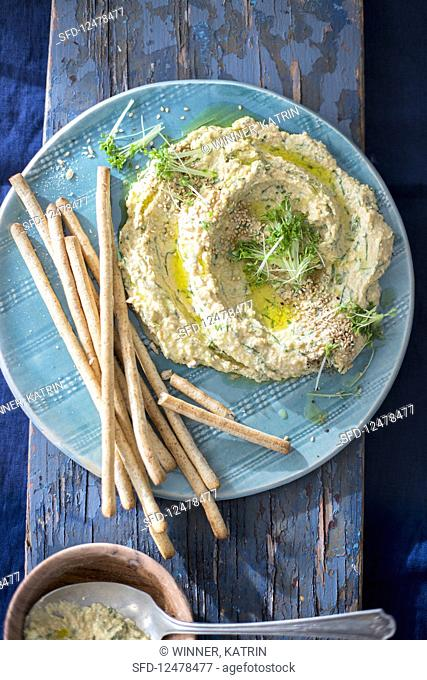Hummus with cress and breadsticks