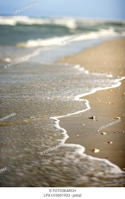 Waves coming onto shore