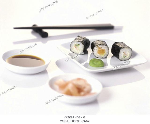 Sushi on plate with chopsticks