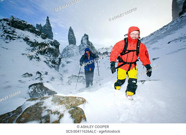 Hikers in a blizzard near the Old Man of Storr on the isle of Skye Scotland