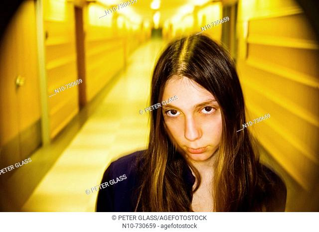 Young woman standing in an office building hallway