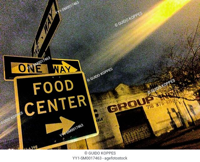 New York, USA. Streetsign by night, directing the the New Fulton Fish Market, on Hunts Point, The Bronx
