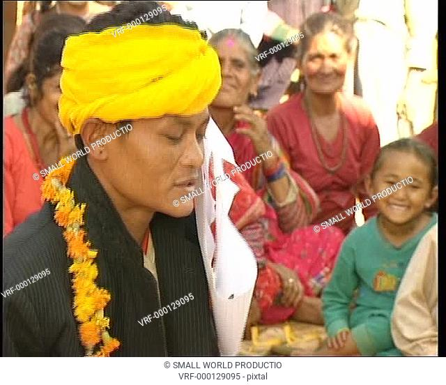 Nepalese man singing in ceremony. Nepal