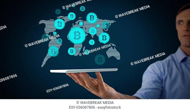 Bitcoin icons on world map with man holding tablet