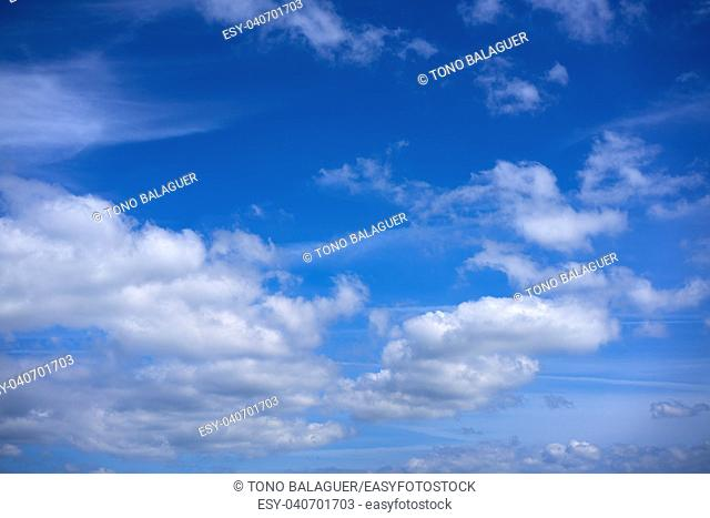 Blue sky with white summer cumulus clouds