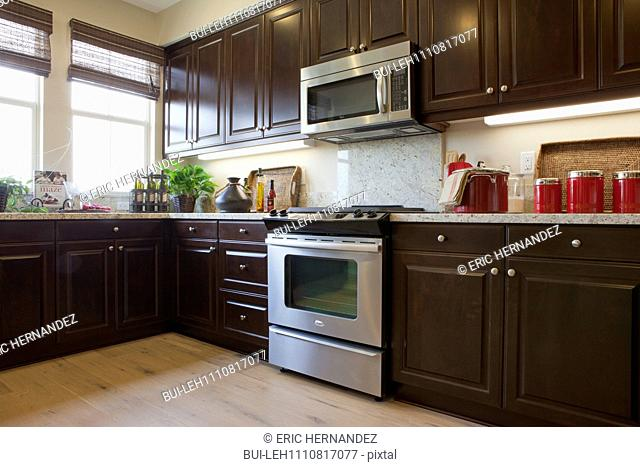 View of a kitchen having brown cabinets at home