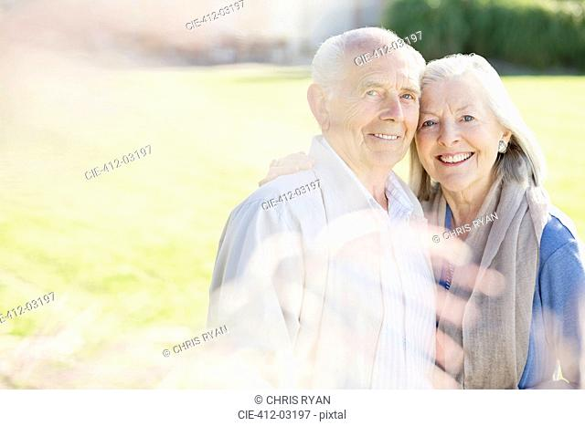 Older couple smiling outdoors