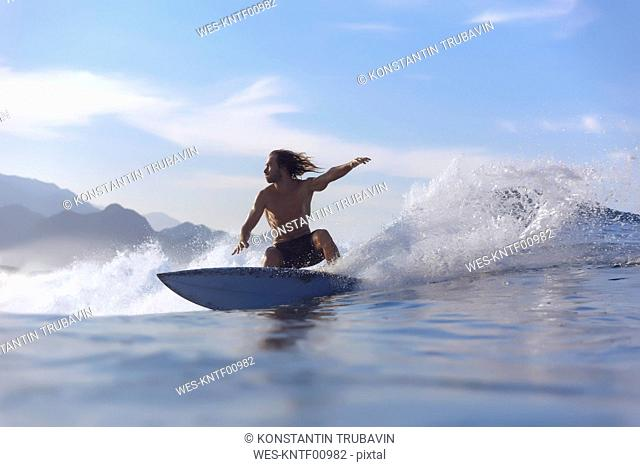 Indonesia, Sumatra, surfer on a wave