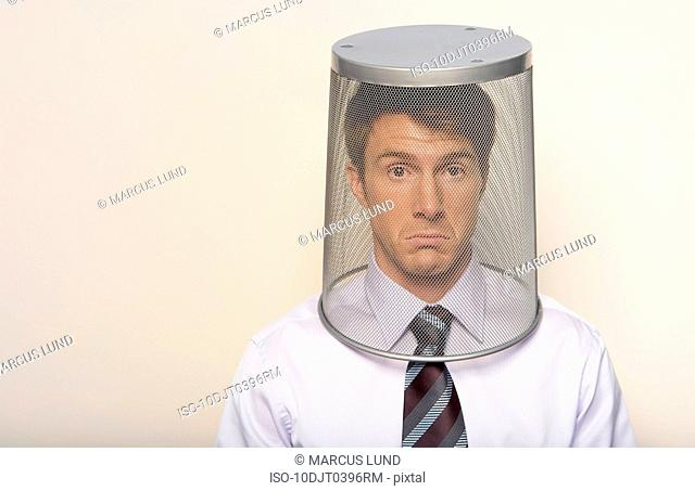 Business man with bin on head