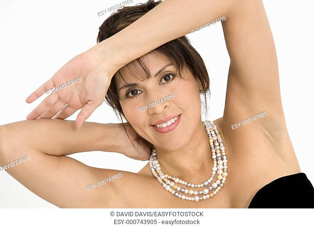 Beautiful Hispanic woman in a black evening gown on a white background