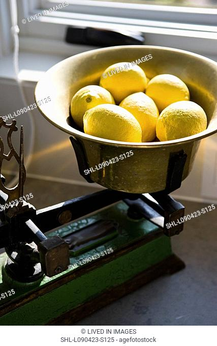 Old kitchen scale with lemons