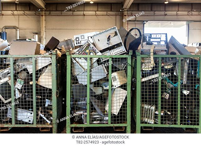 full of appliances and computer equipment for recycling damaged warehouse