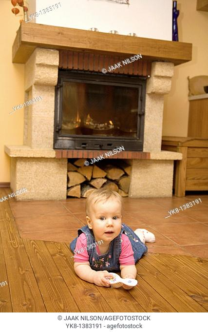 Eight-Month baby crawling by the fireplace in the kitchen