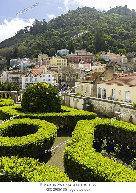 Palacio Nacional de Sintra, the national palace in Sintra, near Lisbon, part of the UNESCO world heritage. View of the town of Sintra from the garden of the...