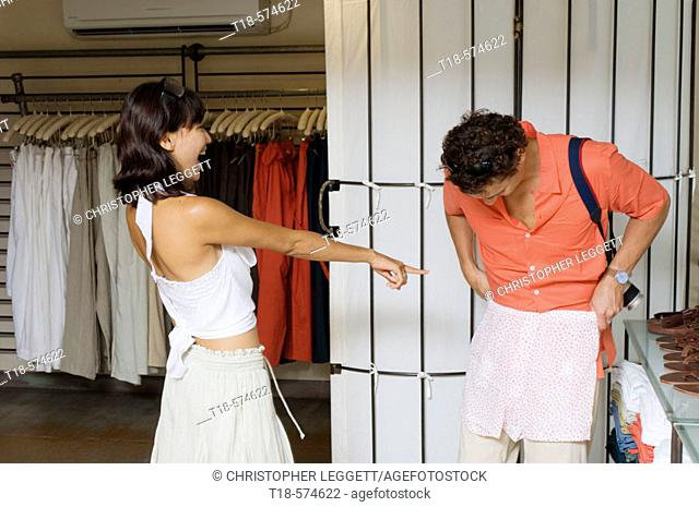 couple choosing clothes at store
