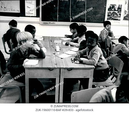 1980 - Wolverhampton, England - School Integration in UK: Students at their desks in class. White and black child studying together at West Park School - only...