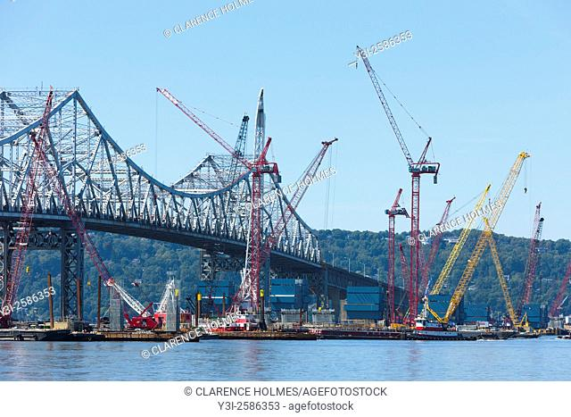 Barge mounted cranes work on construction of the New Tappan Zee Bridge adjacent to the existing bridge over the Hudson River between Westchester and Rockland...