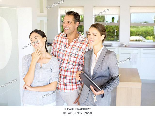 Realtor showing couple house