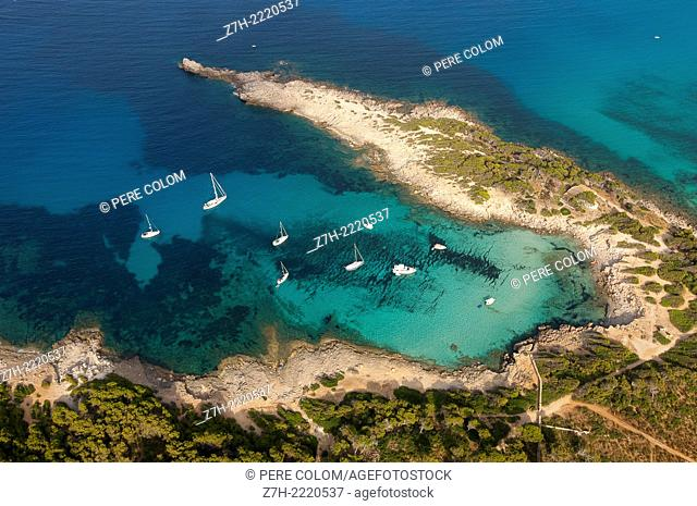 Aerial shot of a beach with anchored boats in the northeast of Mallorca (Majorca, Balearic Island)