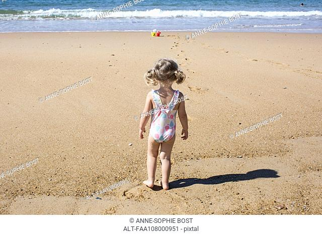 Little girl at the beach, rear view