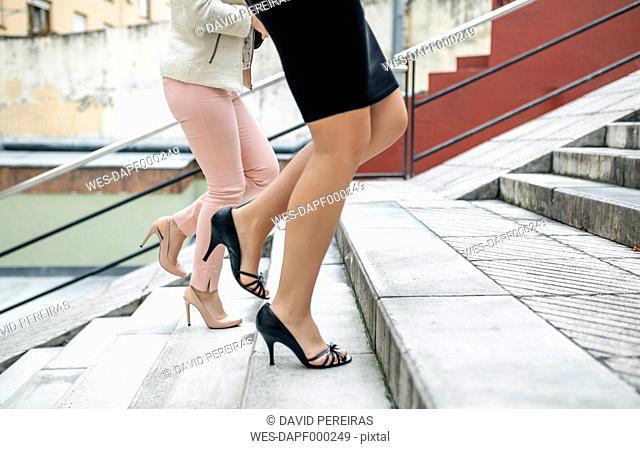 Two businesswomen walking upstairs
