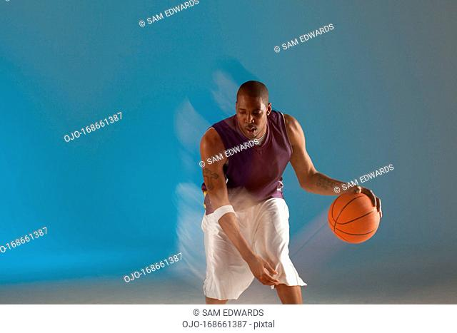 Blurred view of basketball player dribbling