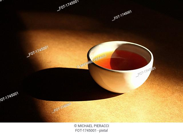 High angle view of fresh tea in cup on table